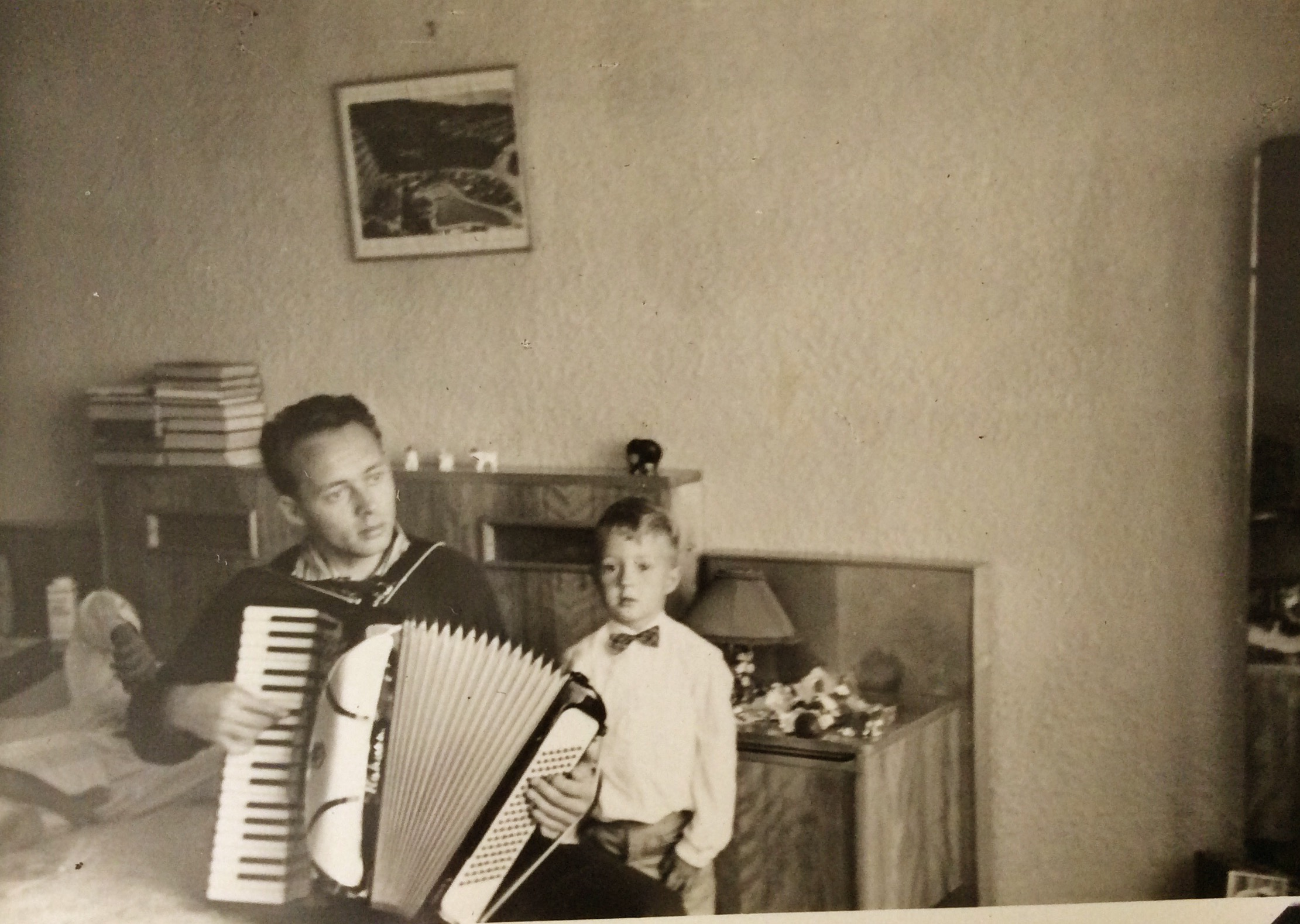 Hans playing my accordion....summer 1961....VREDEHOEK....